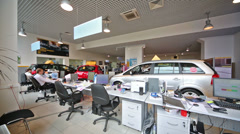 Tables with personnel in office of shop selling cars Stock Footage