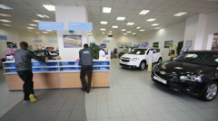 Review hall with clients desk and cars in office of shop selling Stock Footage