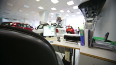 Hall with table and computer in office of shop selling cars Stock Footage