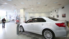 New car at pedestal in dealership Avtomir on Baikalskaya Stock Footage