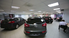 Hall with dark cars in office of shop selling at dealership Stock Footage