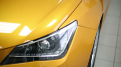 New yellow shining cars stand in office of car shop. Stock Footage