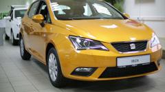 New yellow car stand in light dealership Avtomir on Baikalskaya Stock Footage