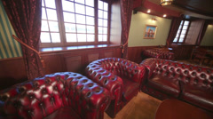Luxurious english cigar room with leather armchairs and tables. Stock Footage