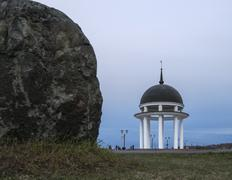 Rotunda and huge rock on the lake quay - stock photo