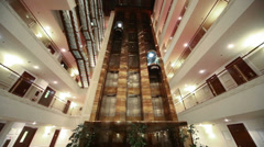 Wide view foors with railings and elevators in modern hotel Stock Footage