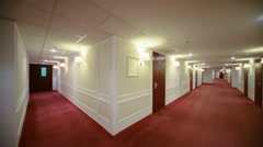 Spacious light hallway with many doors leading into hotel rooms. Stock Footage