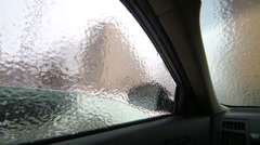 Inside view to crust of opaque ice on the outside car windows. Stock Footage
