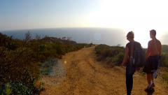 Young Couple Hiking At Crystal Cove State Park- Newport Beach CA Stock Footage