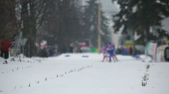 Skiers run during FIS Continental Cup ski racing - stock footage