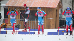skier at start of race during FIS Continental Cup ski racing - stock footage