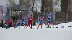 Skiers and spectators during FIS Continental Cup ski racing Stock Footage