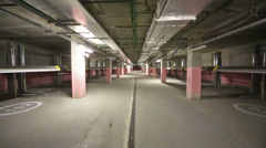 Movement on underground two-level parking with electrolifts Stock Footage