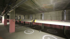 Review two-level electrolifts of underground parking Stock Footage