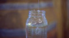 Moonshine bottle bottling Stock Footage