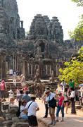 Many tourists at bayon in angkor, cambodia Stock Photos