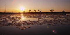 Cranes unload ship at commercial port during iceberg sunset 9 - stock footage