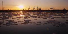 Time lapse of cranes unload ship at commercial port during iceberg sunset 8 Stock Footage