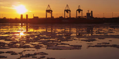 Time lapse of cranes unload ship at commercial port during iceberg sunset 6 - stock footage