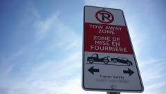 Panning right to no parking sign on a clear blue sky day Stock Footage