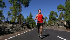 Sport running man - male runner training outdoors Stock Footage