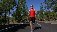 Running man - male runner with determination Stock Footage