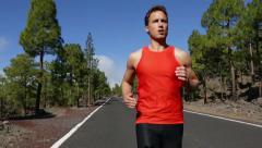 Running man - male runner jogging Stock Footage