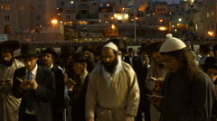 4K UHD Jews pray at the Western Wall during passover holiday Stock Footage