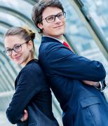 Expressive portrait junior executives of company crossed arms Stock Photos