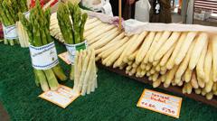 Seasonal fresh Asparagus vegetable sell open market Munich Germany Europe Stock Footage