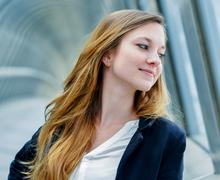 outdoor portrait of a pretty dynamic junior executive - stock photo
