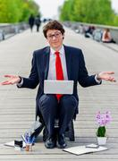 upwardly mobile young executive in job search - stock photo