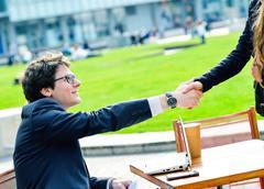 Stock Photo of junior executives dynamics shaking hands