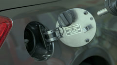 Gas being Pumped - Hand Pumping Gas into Car Tank at Gas Station in Slow Motion Stock Footage