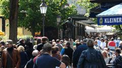 Time Lapse Crowds Consumer Tourists German at Viktualienmarkt market Munich Stock Footage