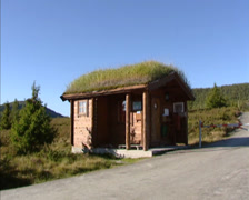NORWAY -  Log cabin at Rondane National Park entrance + pan road Stock Footage