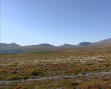 Tundra landscape + pan mountainous plateau and peaks in Rondane national park Stock Footage