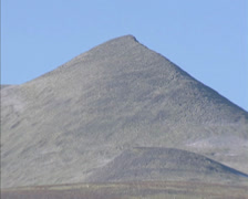 Barren mountain peak + zoom out plateau tundra landscape Rondane national park Stock Footage