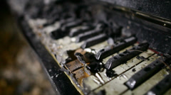 scorched keys of upright piano - stock footage