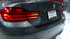 Detail of the new BMW M4 convertible at the New York International Auto Show - stock footage