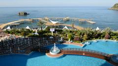 The swimming pool near beach at the luxury hotel, Antalya, Turkey Stock Footage