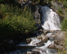 Waterfall in Dovrefjell mountains, flowing downward through the valley Drivdalen Stock Footage