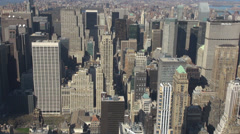 Zoom in aerial view New York NYC Manhattan business tower traffic car street USA Stock Footage
