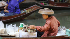 Unidentified people on food boats at Damnoen Saduak floating market . Thailand. Stock Footage