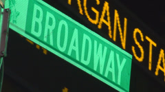Broadway traffic sign NYC New York night light yellow street stock ticker market Stock Footage