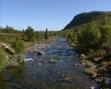 Flowing stream glacial landscape, u-shaped valley, Rondane national park, Norway Stock Footage
