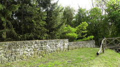 Stone Fence and Path handheld Stock Footage