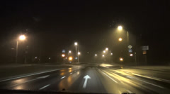 Traffic lights car driving on foggy early morning Stock Footage