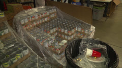 Food bank panRtoL pallets of canned food Stock Footage