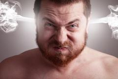 stress concept - angry man with exploding head - stock photo